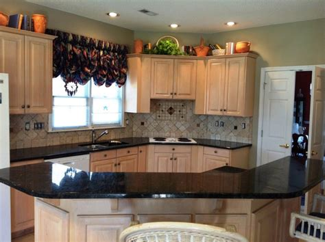 verde peacock granite on light wood kitchen cabinets