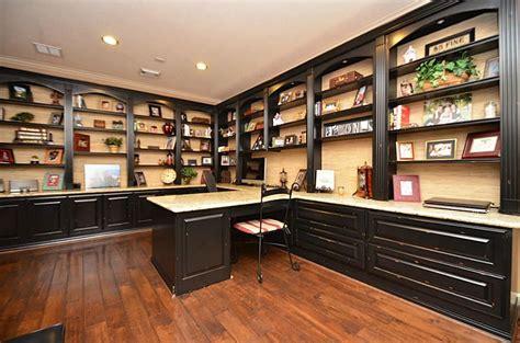 custom study  built  desk granite surface  bookshelves cabinets drawers