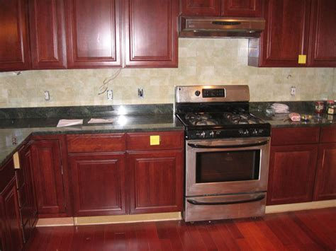 kitchen ideas with cherry cabinets legacy cherry cabinets with granite and ceramic tile
