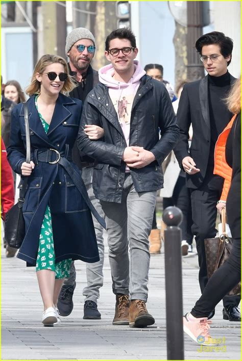 lili reinhart and cole sprouse paris cole sprouse lili reinhart hold hands while sightseeing