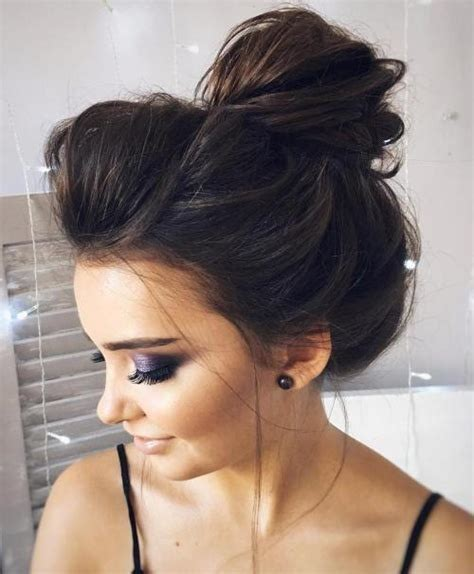 Messy bun hairstyle with braids and wrap messy buns offer little freedom from having to be perfect in all places, including those flyaways we all have. New Messy Bun Hairstyle Ideas With Pictures - May 2021 ...