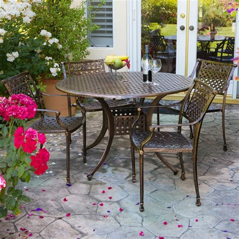 cast aluminum outdoor dining set in copper finish