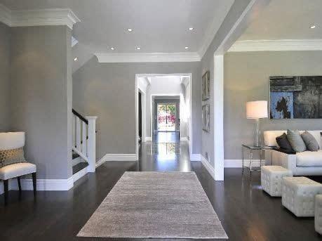flooring for kitchens hardwood floors grey walls white molding baseboards 3456