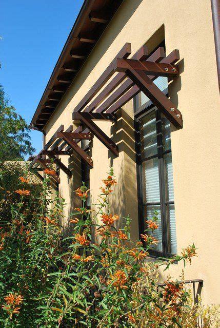 rustic exterior awnings casement windows stucco wall