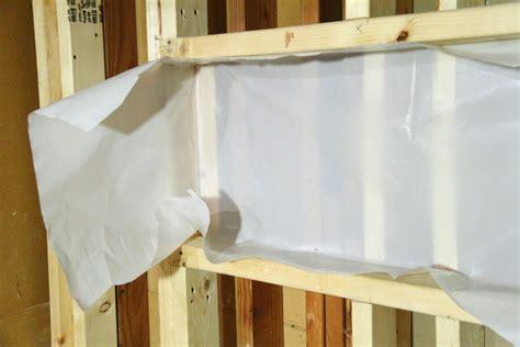 installing the vapor barrier for the bathroom shower