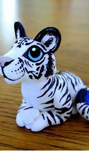 White Tiger with Sapphire by DragonsAndBeasties on DeviantArt