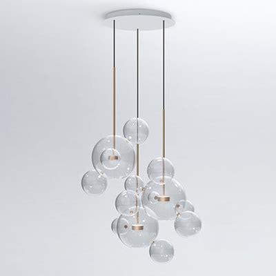 globe glass multi light pendant light brass stem
