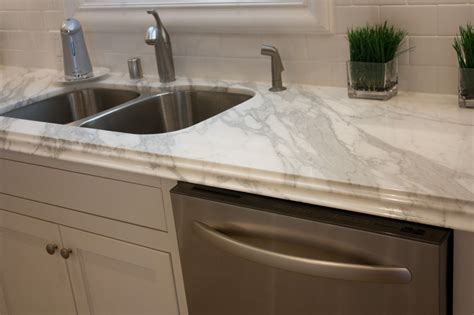 callacutta counter top  taupe cabinets    stainless   countertops kitchen
