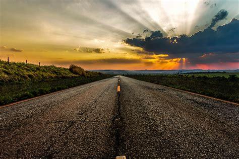 gray concrete road  brown mountain  golden