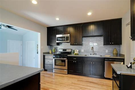 espresso kitchen cabinets with light floors espresso cabinets and light hardwood floors kitchen in