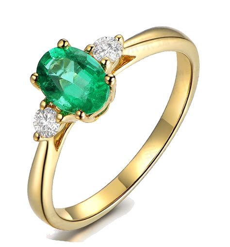 emerald and engagement rings trilogy half carat oval cut emerald and engagement ring in yellow gold jeenjewels