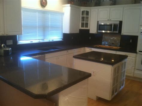 amarone granite countertops and high backsplash with a