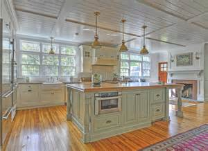 green kitchen islands riveting green kitchen island with industrial pendant lighting fixtures in polished brass