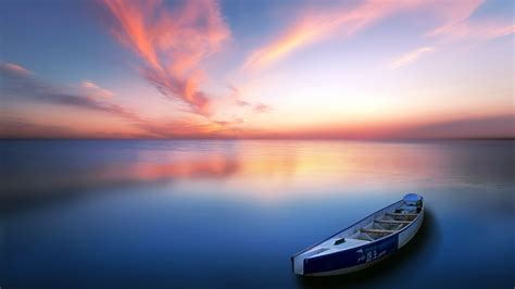 calm lake sunset boat skyline scenery preview