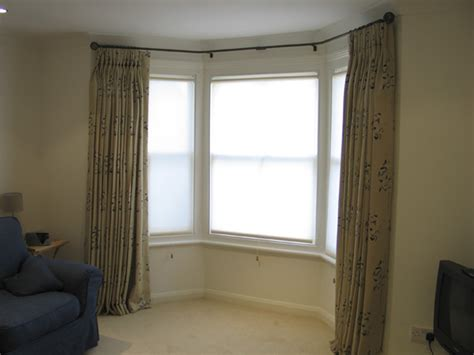 roller blinds with curtains on bay window pole tufnell