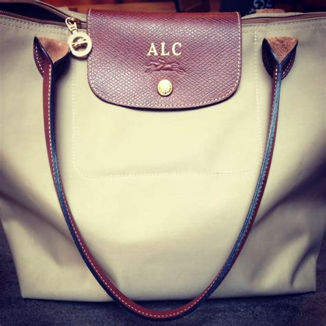 embossed monogrammed initials longchamp handbags