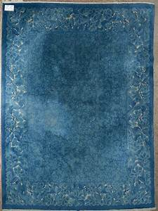 grand tapis chinois au decor floral bleu et beige usures With tapis beige et rouge