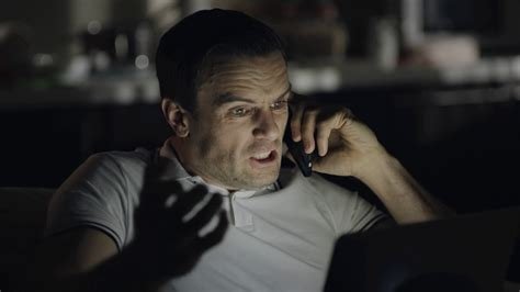 Closeup angry man screaming during phone call at night office. Tired business man finishing ...