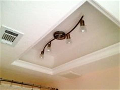 Changing Light Fixture In Bathroom by How To Replace Fluorescent Lighting With A Pendant Fixture