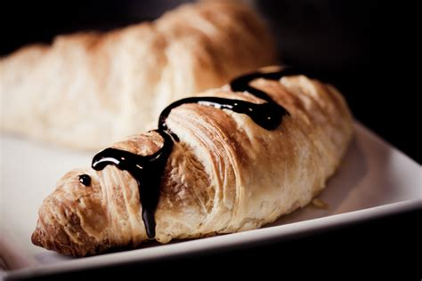 eating  chocolate croissant  day   month