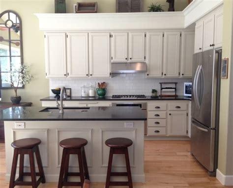 beige kitchen cabinets beige kitchen cabinets with white subway tile design do