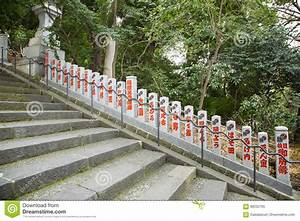 Row, Of, Posts, Along, Stairs, With, Japanese, Writing, Stock, Image