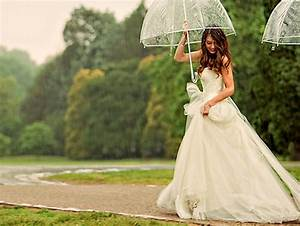 umbrellas for rainy wedding days With umbrella wedding photos