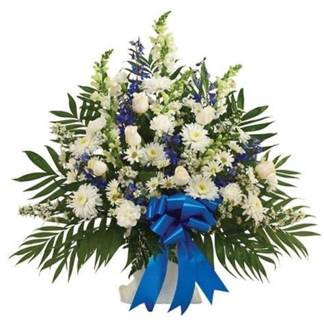 blue white sympathy floor basket  send flowers
