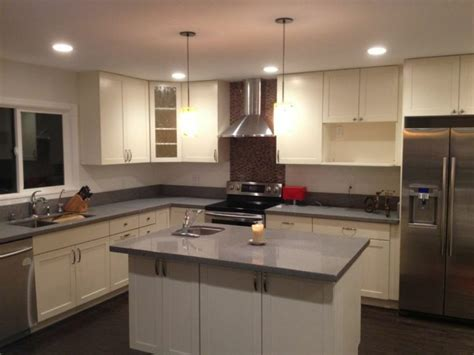 eggshell white white c c cabinets and granite
