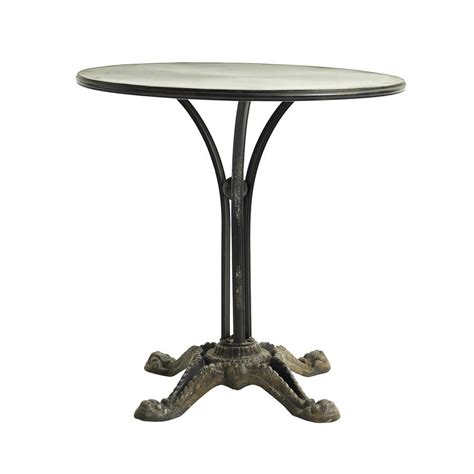 cast iron patio table by out there exteriors