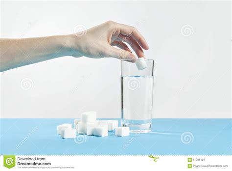glass of water and cube sugar diabetes disease sweet