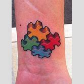 cross-tattoo-on-finger