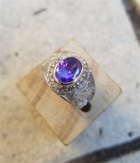 kingston college class graduation ring with purple stone