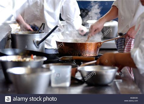 Royalty free photograph of restaurant kitchen cooking busy