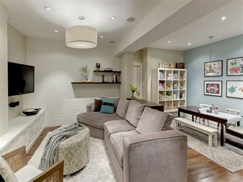 large contemporary mirrors small basement family room