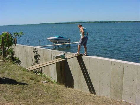 concrete sea wall fishing hull