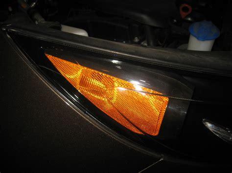kia sportage headlight bulbs replacement guide 033