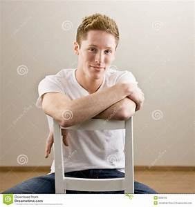Young Man Sitting Backwards In Chair Stock Photos - Image ...