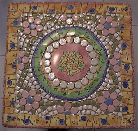 small mosaic table top view using dishes tiny tile and