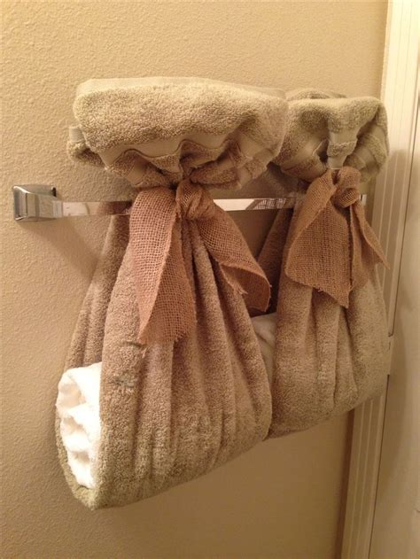 towel folding ideas for bathrooms how to fold hanging bathroom towels decoratively