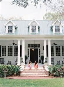 simple plantation style homes placement two sitting on front porch of plantation home http