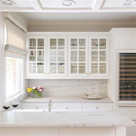 glass front kitchen cabinets  gold knobs