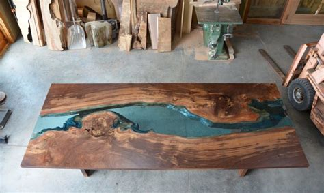 escape   glass rivers  lakes   beautiful wood tables inhabitat green design