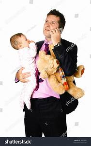 Young Businessman Father Holding His Baby And Teddy Under ...