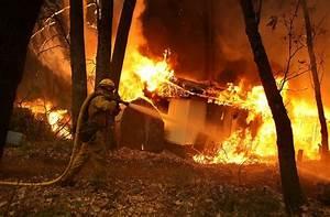 California Wildfires Claim Lives and Rip Through Massive ...
