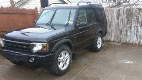 sell   orange land rover discovery  lmited