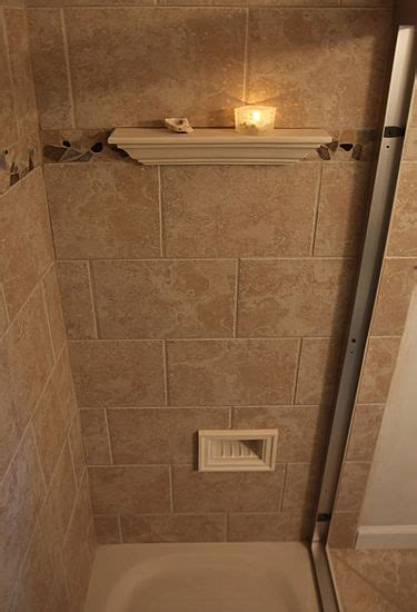 great idea  integrated shower foot rest located