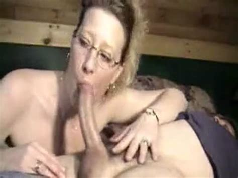 Mature Woman In Glasses Sucking Cock At