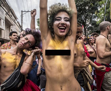 rio de janerio carnival topless women and raucous dancers
