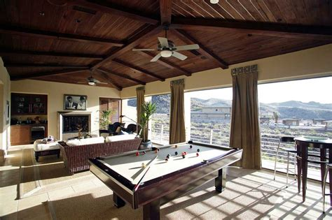 pool table in living room living room with pool table in beige and brown color